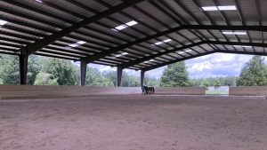 Riding lessons under a covered arena at New Era Farm